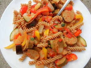 Whole wheat pasta with summer vegetables and vegan sausage